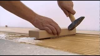 Full spread gluing of tilo parquet floors