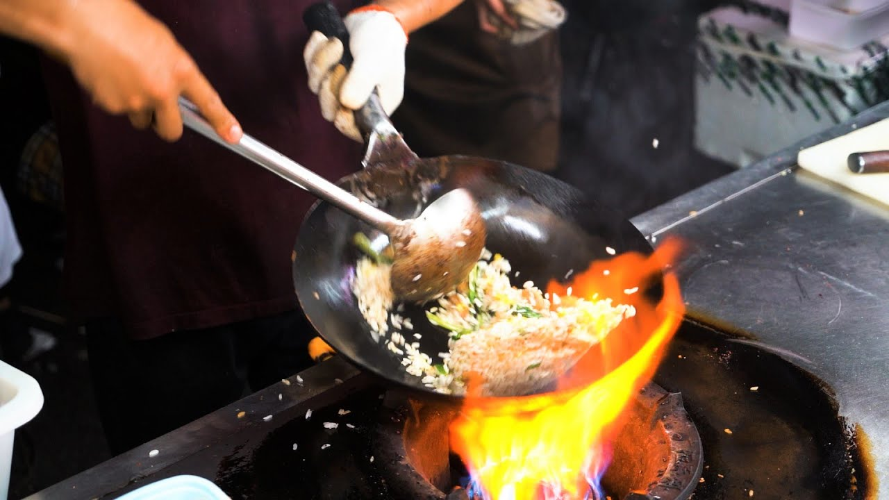 Chinese Street Food -Night market  fried rice with eggs, street sugar painting Mickey Butterfly