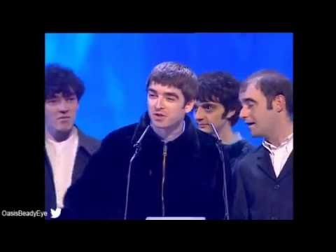 Oasis wins British Newcomer presented by Ray Davis at BRIT Awards 1995