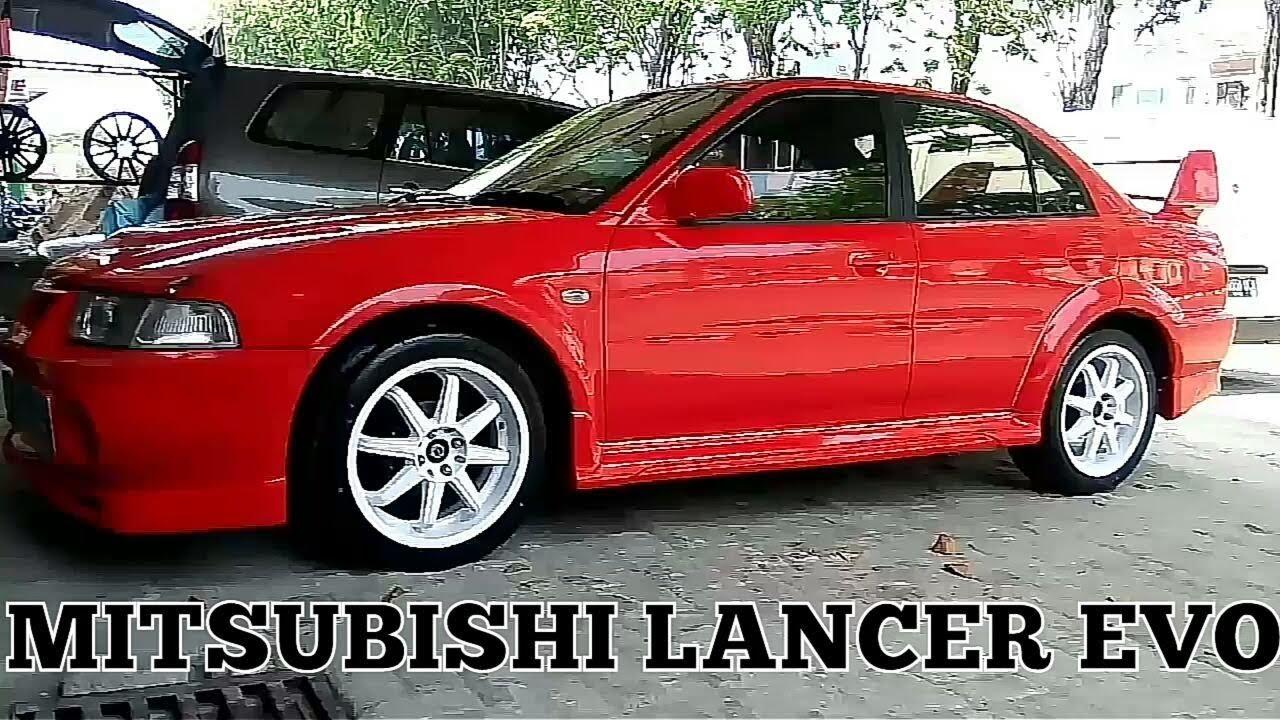 Modifikasi Mitsubishi Lancer Evo Ban Semi Slick Accelera