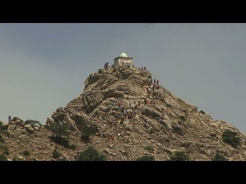 Pilgrims cast prayers to the skies from Algeria mountain peak