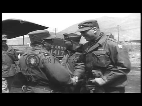 United States soldiers advance on the battlefield and Korean refugees evacuate an...HD Stock Footage