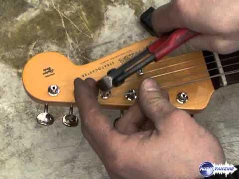 Changer les cordes d'une guitare électrique type ...