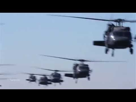 California Army National Guard helicopters take off in formation