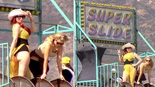 Phoebe Price Flashes Her Derriere Atop The Super Slide At Malibu Carnival