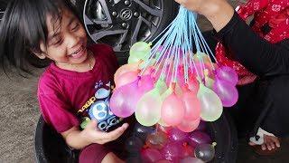 Gambar cover Serunya Bermain Air dan Main Lempar Lemparan Balon Air Bersama Keluarga