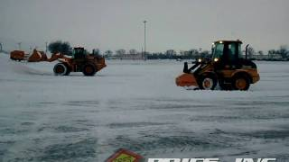 PRIES, INC. - Case & John Deere wheel loaders plowing snow