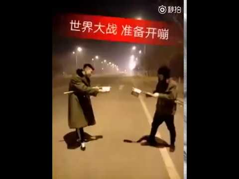 Extremely dangerous street fight: Two guys launch firework fight during Spring Festival