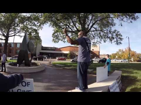 Robert Gray Preaches Outside Clayton High