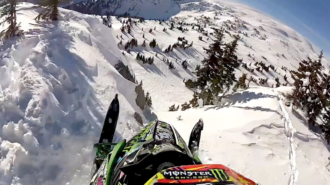 GoPro Snowmobile Cliff Huck YouTube - This is what happens when you fly a snowmobile off a cliff
