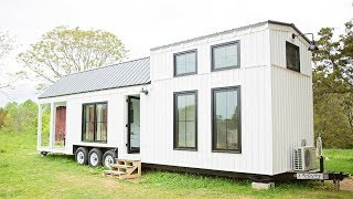 This Farmhouse Style Tiny House On Wheels Fits Family Of Four | Living Design For A Tiny House
