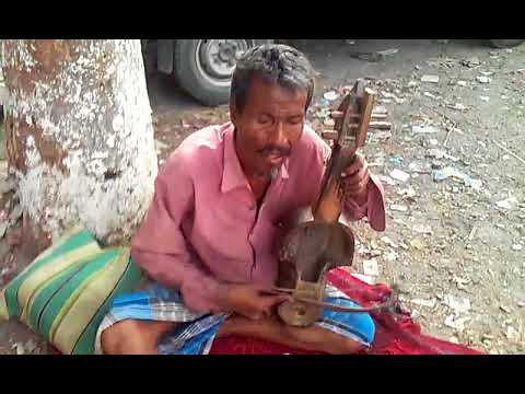 'pagol mon ta re boli' bengali heart touching song sang by indian street singer...