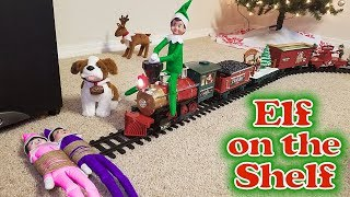 Purple & Pink Elf on the Shelf - Green Prankster Elf Rides the Train! Day 12