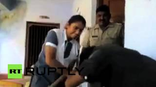 Revenge: Indian teenager beats guy who harassed her, while cops watch