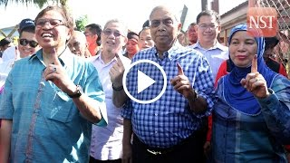 Crowd swarms Adenan as he arrives to cast vote