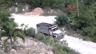 Ford L8000 Dump Truck Climbing Hill With a Load of Asphalt