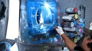 Spray Paint Art - guy creating an outer space scene on streets of Montreal