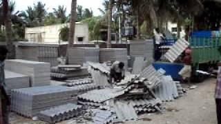 Asbestos Cement sheet cutting, Pondicherry,India April 6,2010