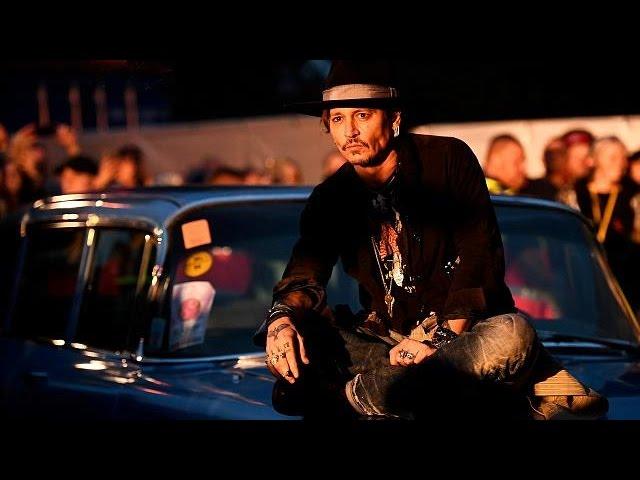 Johnny Depp makes an entrance at Glastonbury