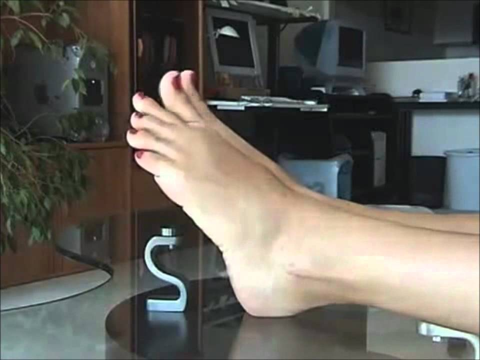 Perfect clean female feet . Beautiful womens hand touches