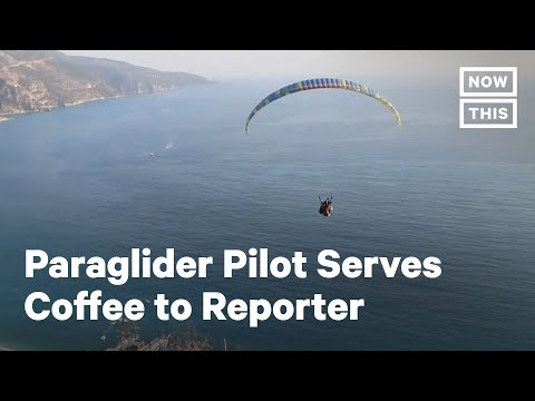 Paraglider Pilot Serves Coffee to Reporter   NowThis