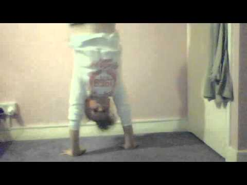 girl trying to do a handstand against a wall  youtube