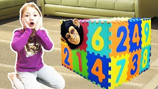 Michelle and monkey play with colorful surprise magic box