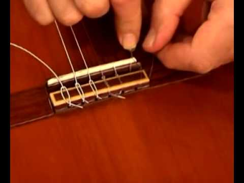 how to change classic guitar strings youtube. Black Bedroom Furniture Sets. Home Design Ideas