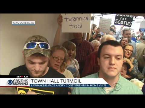 Lawmakers face angry constituents at town hall meetings
