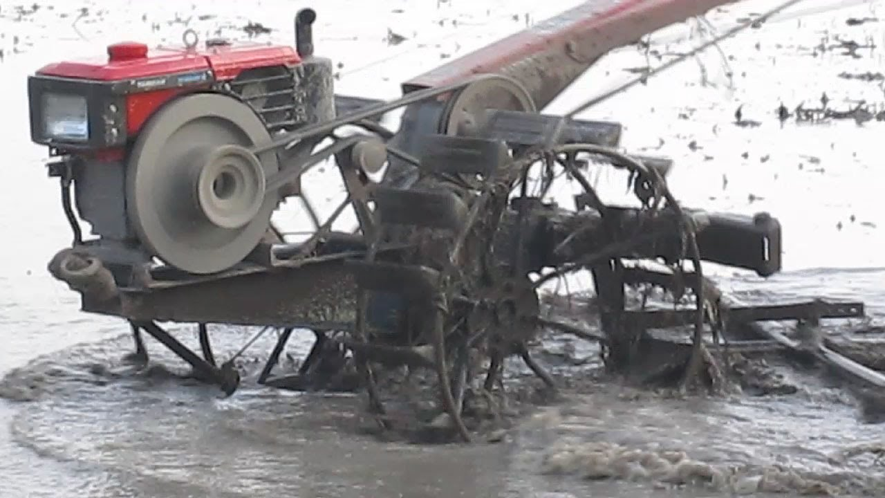Yanmar Tractor 2 Wheel : Yanmar two wheel tractor ripping grading mud for paddy