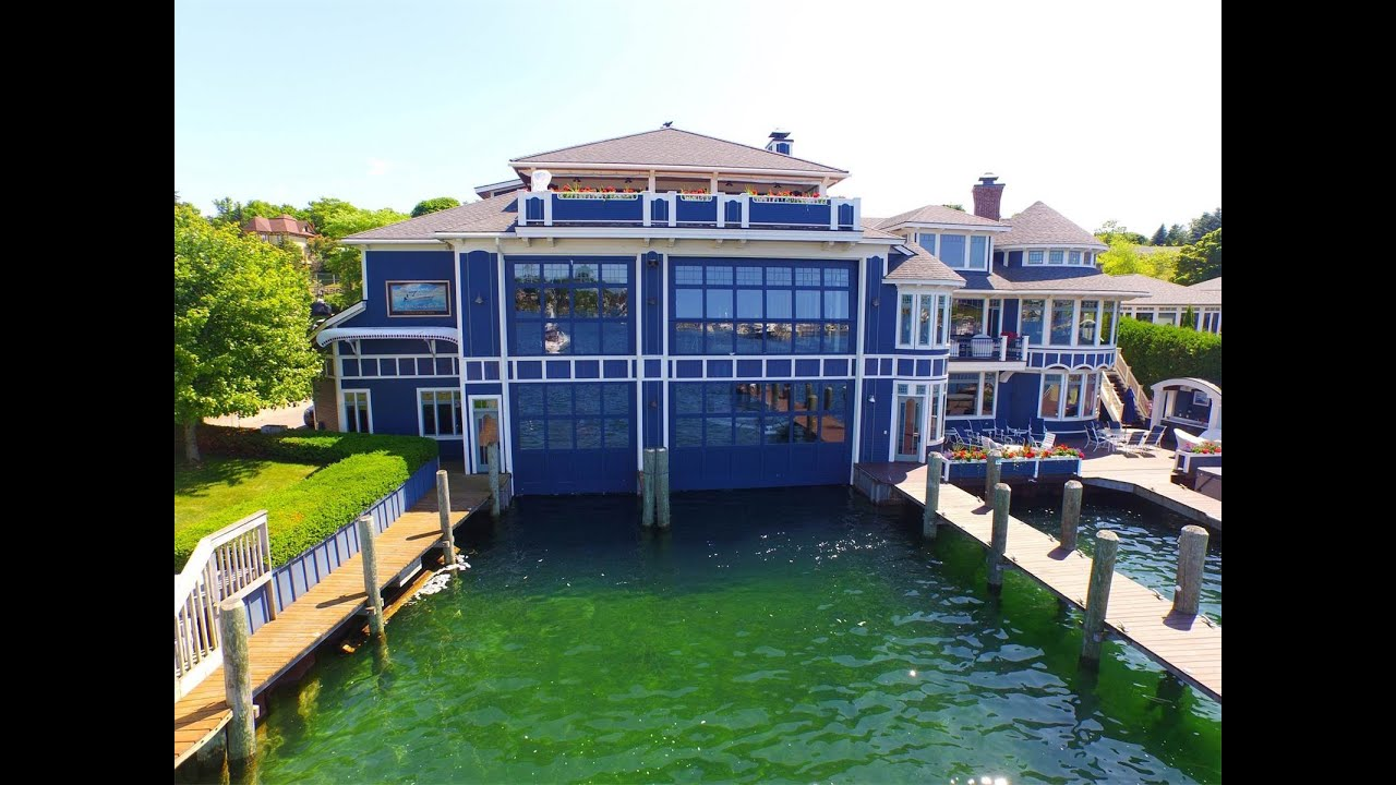 Round lake estate and boat house in charlevoix michigan for Building a home in michigan