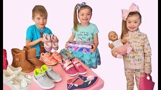 Funny kids play in the shoe store by Dominika Show