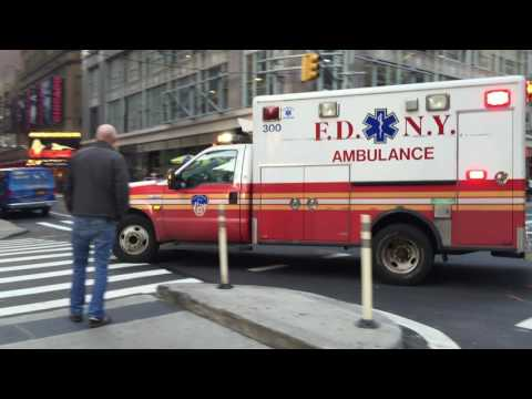 FDNY EMS AMBULANCE RESPONDING ON WEST 49TH STREET IN THE MIDTOWN AREA OF MANHATTAN IN NEW YORK CITY.