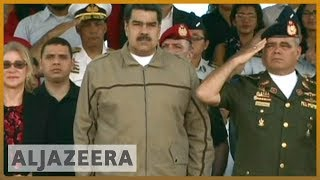 Venezuela Crisis: Maduro denounces 'minority of opportunists and cowards'   Al Jazeera English As Venezuelan President Nicolas Maduro and opposition leader Juan Guaido rally their supporters, neither side is showing signs of backing down., From YouTubeVideos