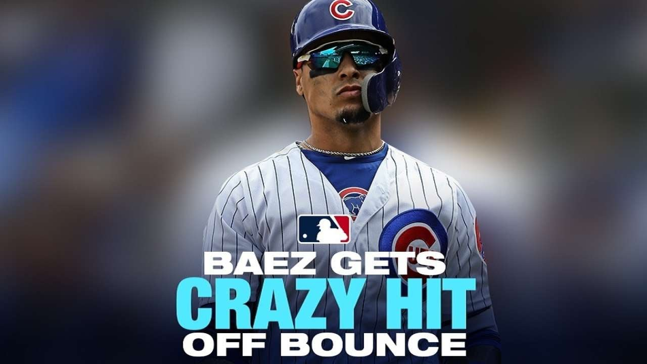 Crazy play! Baez throws bat at bouncing ball for hit