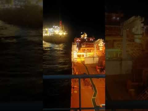 Shuttle tanker loading at FPSO