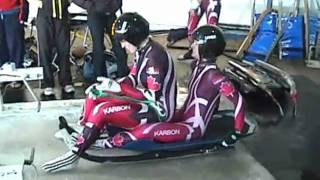 Andrea and Monica try doubles luge in the ice house