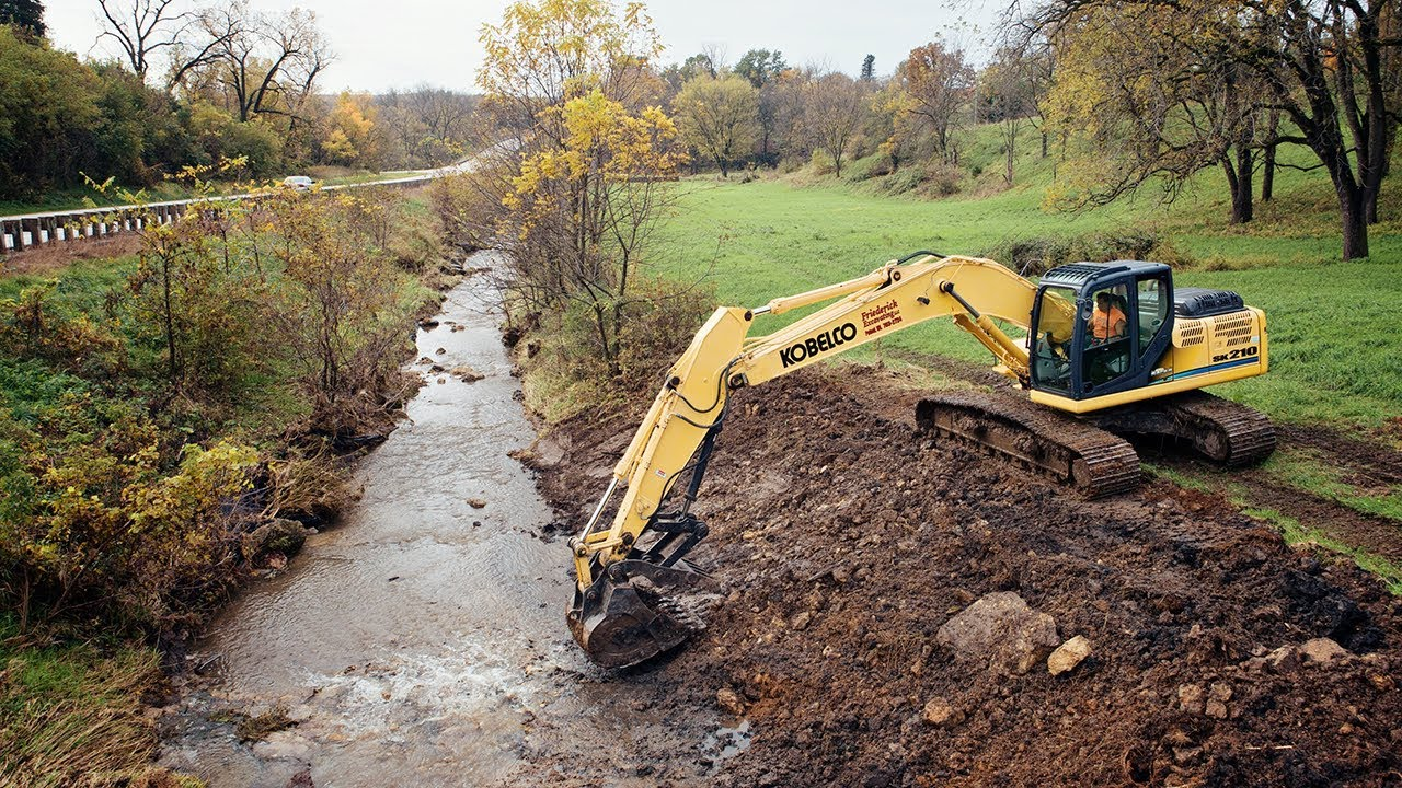creek-dredging-filling-washout-with-excavator