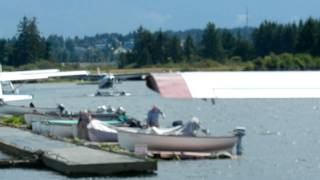 Seair Turbine Cessna Caravan backing out of Vancouver Island Air Seaplane Dock Campbell River BC