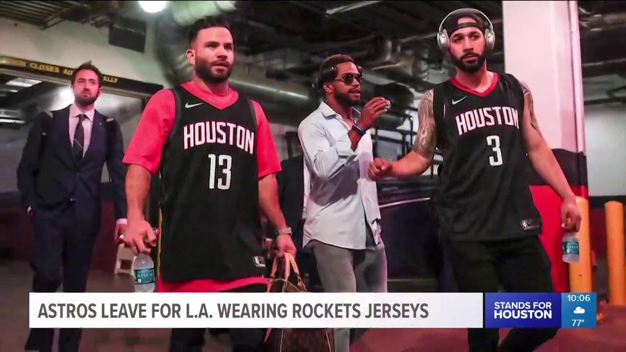 bd7151ebf74 Astros leave for LA wearing Rockets jerseys - YouTube