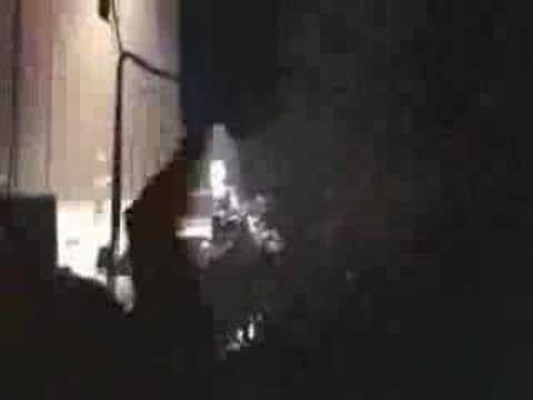 Axl Rose faces up to security men who were beating a fan