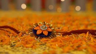 Beautiful colored rakhi placed on flower petals on the occasion of Raksha Bandhan