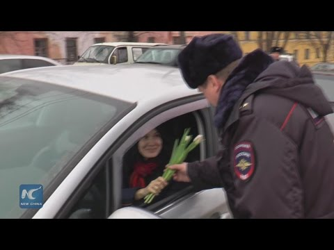 Women drivers get flowers from police in central Russia