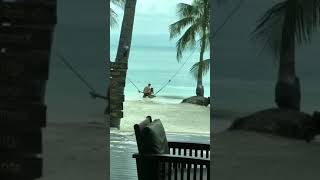 Romantic Couple Tumble into Sea Trying to Ride Swing - 1011371