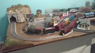 Three MTH ProtoSound 2 trains running smoothly on a 12x5 layout