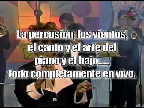 Clase de Rumba con Orquesta en Vivo.