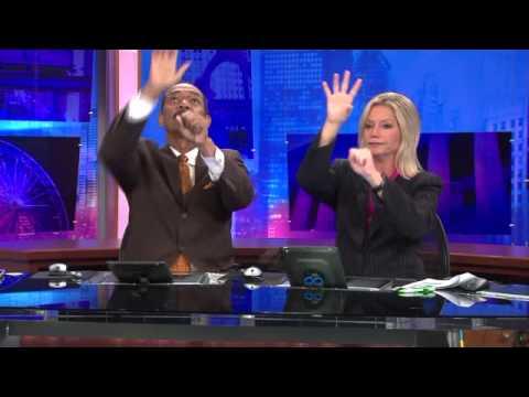 WGN-TV Anchors Robert Jordan and Jackie Bange`s commercial break handshake