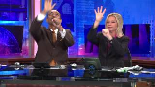 WGN-TV Anchors Robert Jordan and Jackie Bange`s commercial break handshake