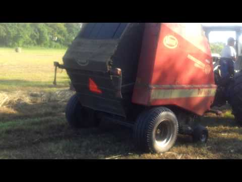 Round Baling Hay, Ford 6610 tractor, Vicon RV 1601