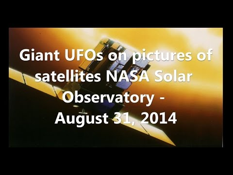 Giant UFOs on pictures of satellites NASA Solar Observatory - July 31, 2014